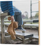 Young boy sitting by himself on on bleachers. Wood Print