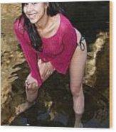 Young Hispanic Woman In Creek Wood Print
