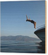 Young Man Flips Off A Boat At Sunset Wood Print