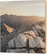 Young Man Scrambles To The Summit Wood Print