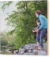 Young Mother Helping Son Fish At Kezar Wood Print
