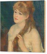 Young Woman Braiding Her Hair Wood Print