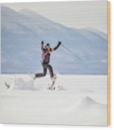 Young Woman Jumping While Snowshoeing Wood Print