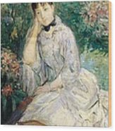 Young Woman Seated On A Sofa Wood Print