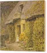 A Child At The Doorway Of A Thatched Cottage  Wood Print