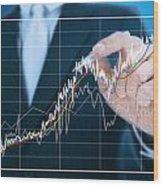Businessman Writing Graph Of Stock Market  Wood Print by Setsiri Silapasuwanchai