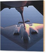 A B-2 Spirit Bomber Conducts Wood Print by Stocktrek Images