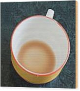 A Cup With The Remains Of Tea On A Green Table Wood Print