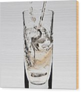 A Drink Being Poured Into A Glass Wood Print