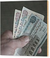 A Hand Holds Egyptian Pounds In Cash Wood Print