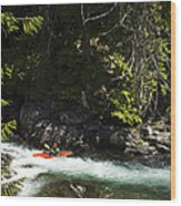 A Kayaker Paddles In A Rapid As Seen Wood Print