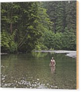 A Man Wades In A River In A Temperate Wood Print by Taylor S. Kennedy