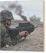 A Peruvian Marine Assaults A Beach Wood Print