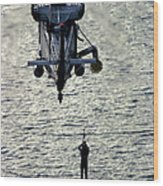 A Search And Rescue Swimmer Is Hoisted Wood Print