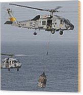 A Sh-60j Seahawk Transfers Cargo Wood Print