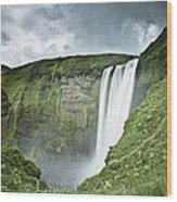 A Waterfall Over A Grassy Cliff Wood Print