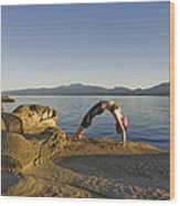 A Woman Does Yoga At Sunset Wood Print by Taylor S. Kennedy