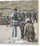 An Afghan Police Student Loads A Rpg-7 Wood Print by Terry Moore