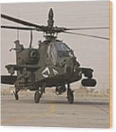 An Ah-64 Apache Helicopter Taxiing Wood Print