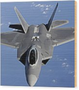An F-22 Raptor Moves Into Position Wood Print
