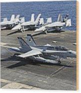 An Fa-18e Super Hornet Lands Aboard Wood Print