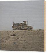 An Mrap Vehicle Patrols The Ridge Wood Print