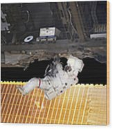 Astronaut Participates In A Spacewalk Wood Print