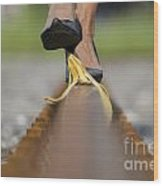 Banana Peel On The Railroad Tracks Wood Print