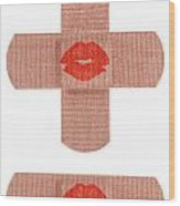 Bandages With Kiss Wood Print by Blink Images