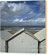 Beach Huts Under A Stormy Sky In Normandy Wood Print