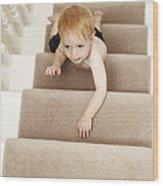 Boy Climbing Stairs Wood Print