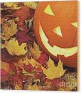 Carved Pumpkin On Fallen Leaves Wood Print