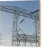 Electricity Pylons Against A Clear Blue Wood Print