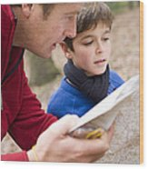 Father And Son Reading A Map Wood Print