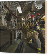 Firemen Combat A Simulated Fire Aboard Wood Print