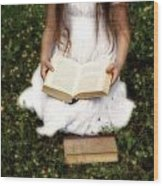 Girl Is Reading A Book Wood Print