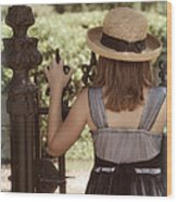 Girl Looking Over Iron Gate Wood Print
