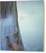 Girl With Baby Doll Wood Print
