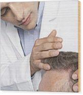 Hair Transplant Consultation Wood Print by Adam Gault