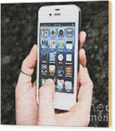 Hands Holding An Iphone Wood Print by Photo Researchers, Inc.