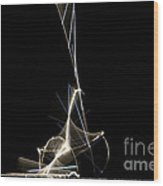 High Speed Strobe Image Of Pin Dropping Wood Print