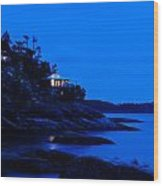 Illuminated Cabin In The Dark At The Seaside Wood Print