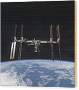 International Space Station Backdropped Wood Print