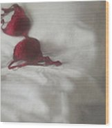 Red Brassiere Laying On Bed Wood Print