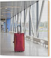 Rolling Luggage In An Airport Concourse Wood Print