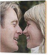 Smiling Couple Embracing Wood Print