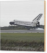 Space Shuttle Discovery Touches Wood Print