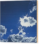 Sunlit Fluffy White Clouds In A Blue Wood Print
