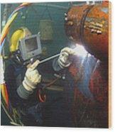 U.s. Navy Diver Welds A Repair Patch Wood Print