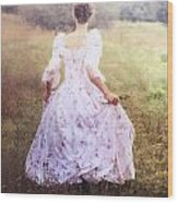 Woman In A Meadow Wood Print